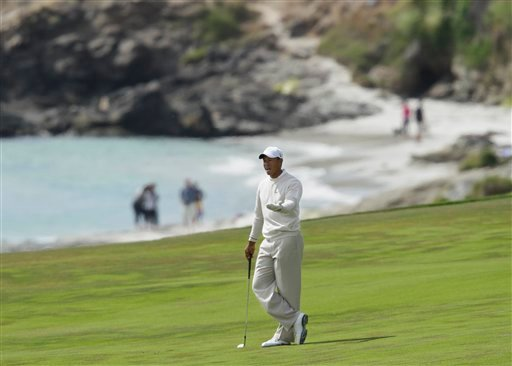 Tiger Woods reacts after his second shot on the 10th hole during the third round of the U.S. Open golf tournament Saturday, June 19, 2010, at the Pebble Beach Golf Links in Pebble Beach, Calif. (AP Photo/Eric Risberg)
