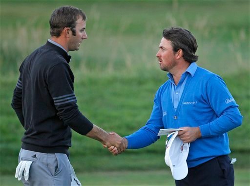 Graeme McDowell of Northern Ireland, right, shakes hands with Dustin Johnson after the third round of the U.S. Open golf tournament Saturday, June 19, 2010, at the Pebble Beach Golf Links in Pebble Beach, Calif. (AP Photo/Matt Slocum)