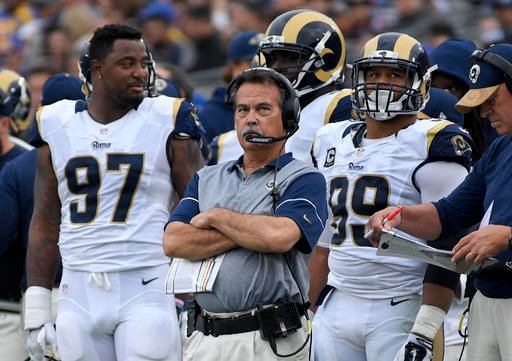 Los Angeles Rams head coach Jeff Fisher watches during the first half of an NFL football game against the Atlanta Falcons Sunday, Dec. 11, 2016, in Los Angeles.
