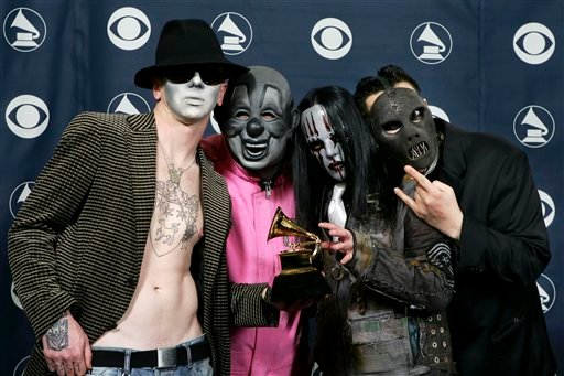 """FILE - In this Feb. 8, 2006 file photo, the group Slipknot pose with their award for best metal performance for """"Before I Forget"""" at the 48th Annual Grammy Awards in Los Angeles."""
