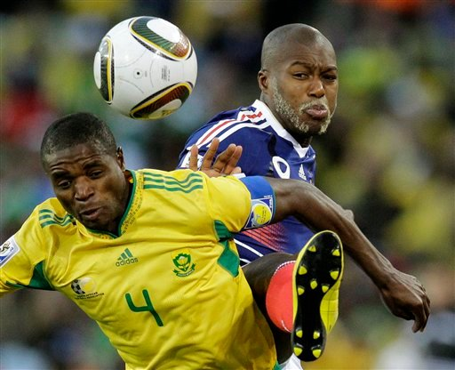 South Africa's Aaron Mokoena, left, competes for the ball with France's Djibril Cisse, right, during the World Cup group A soccer match between France and South Africa at Free State Stadium in Bloemfontein, South Africa 6/22/2010. (AP Photo/Themba Hadebe)
