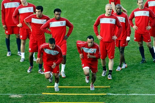 U.S. national soccer midfielders Benny Feilhaber, lower left, and Landon Donovan, lower right, lead the team in a drill during training at Pilditch Stadium in Pretoria, South Africa.