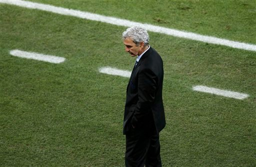 France head coach Raymond Domenech reacts during the World Cup group A soccer match between France and South Africa at Free State Stadium in Bloemfontein, South Africa, Tuesday, June 22, 2010. (AP Photo/Hassan Ammar)