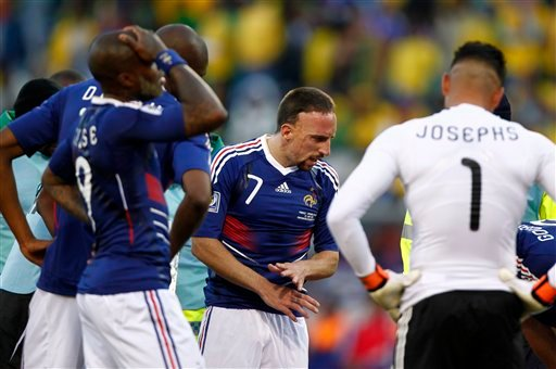 rance's Djibril Cisse, left, and France's Franck Ribery, center, react after a foul on South Africa's Macbeth Sibaya, not seen, by France's Yoann Gourcuff, partially visible at right, during the World Cup group A soccer match.