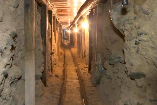 This frame grab taken from a Monday, Dec. 12, 2016 video provided by the Mexican Attorney General's Office, or PGR, shows one of two tunnels found in an area of warehouses in the border city of Tijuana that lead into California.
