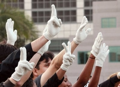 In this June 25, 2009 file photo, fans hold up a sea of single-gloved hands in an impromptu celebration of the life of Michael Jackson, outside UCLA Medical Center after he was pronounced dead there in Los Angeles.