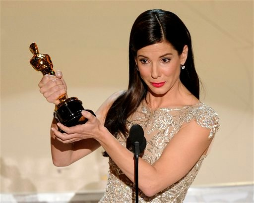 "n this March 7, 2010 file photo, Sandra Bullock accepts the Oscar for best performance by an actress in a leading role for ""The Blind Side"" at the 82nd Academy Awards in the Hollywood section of Los Angeles. (AP Photo/Mark J. Terrill, file)"