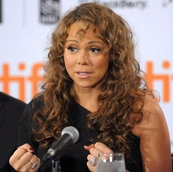 In this Sept. 13, 2009 photo, singer-actress Mariah Carey participates in news conference for the film 'Precious' during the Toronto International Film  Festival in Toronto. Veterinarian Cindy Bressler sued Carey on Wednesday, June 23, 2010, in New York.
