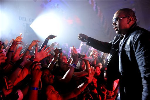 In this photo taken Wednesday, June 23, 2010, Timbaland performs at a graduation party for students at Culver City High School in Culver City, Calif. (AP Photo/Kristian Dowling)