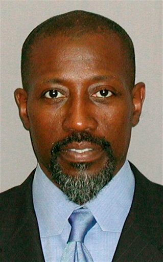 Actor Wesley Snipes is seen in an undated booking photo provided by the United States Marshall Service. Snipes' attorneys are hoping that the arrest of his former financial adviser, Kenneth Starr, could pave the way for a new trial on tax evasion charges