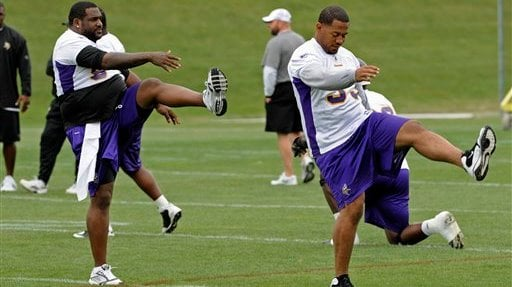 Minnesota Vikings defensive tackles Pat Williams, left, and Kevin Williams go through drills during NFL football practice, Wednesday, June 2, 2010 in Eden Prairie, Minn. (AP Photo/Jim Mone)