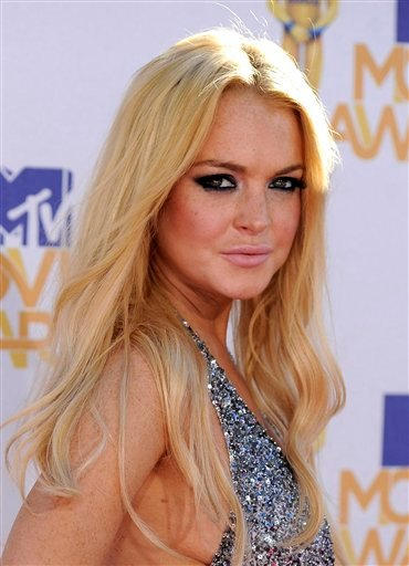 n this June 6, 2010 file photo, Lindsay Lohan arrives at the MTV Movie Awards in Universal City, Calif. (AP Photo/Chris Pizzello, file)