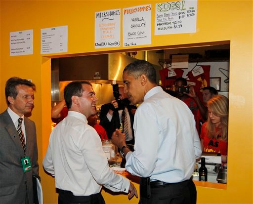 President Barack Obama and Russia's President Dmitry Medvedev order as they make an unscheduled visit to Ray's Hell Burger.
