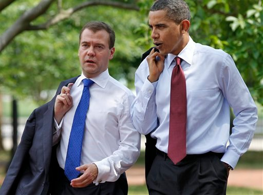 President Barack Obama and Russian President Dmitry Medvedev walk through Lafayette Park in Washington, Thursday, June 24, 2010, from the White House to a attend a meeting at the U.S. Chamber of Commerce. (AP Photo/J. Scott Applewhite)
