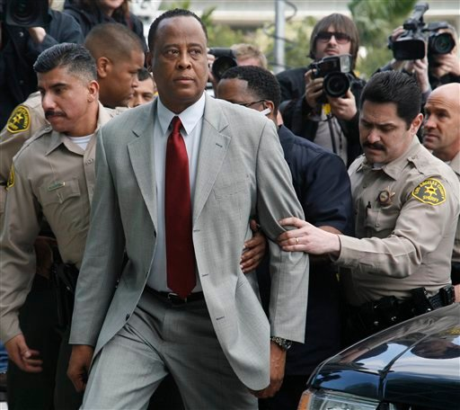 In this Feb. 10, 2010 file photo, Conrad Murray, Michael Jackson's doctor, is escorted by Los Angeles County Sheriffs deputies as he arrives at the Airport Courthouse to face charges of involuntary manslaughter in the singer's death in Los Angeles.