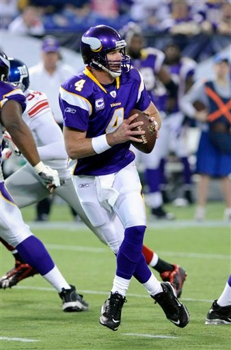 In this Jan. 3, 2010, file photo, Minnesota Vikings quarterback Brett Favre (4) drops back to pass during an NFL football game against the New York Giants in Minneapolis.