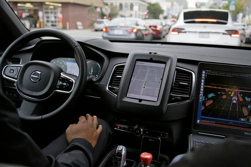 In this photo taken Tuesday, Dec. 13, 2016, an Uber driverless car waits in traffic during a test drive in San Francisco.