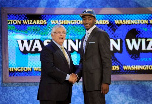 NBA commissioner David Stern, left, poses with the No. 1 overall draft pick John Wall, of Kentucky, who was selected by the Washington Wizards with the No. 1 pick in the NBA basketball draft Thursday, June 24, 2010 in New York. (AP Photo/Bill Kostroun)