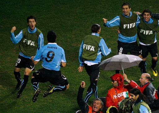 Uruguay's Luis Suarez, second from left, celebrates after scoring a goal with fellow team members during the World Cup round of 16 soccer match between Uruguay and South Korea at Nelson Mandela Bay Stadium. (AP Photo)