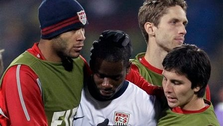 United States' Maurice Edu, center, is comforted by teammates at the end of the World Cup round of 16 soccer match between the United States and Ghana at Royal Bafokeng Stadium in Rustenburg, South Africa, Saturday, June 26, 2010. (AP Photo/Matt Dunham)