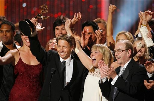 "Bradley P. Bell, left, and the cast and crew of ""The Bold and the Beautiful"" celebrate as they accept the award for outstanding drama series at the 37th Annual Daytime Emmy Awards on Sunday, June 27, 2010, in Las Vegas."