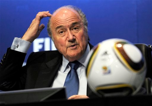 The April 23, 2010 file photo shows FIFA President Joseph Blatter answering journalist's questions during a press conference on the 2010 Soccer World Cup in South Africa at the FIFA headquarters in Zurich, Switzerland. (AP Photo/Keystone, Steffen Schmidt)
