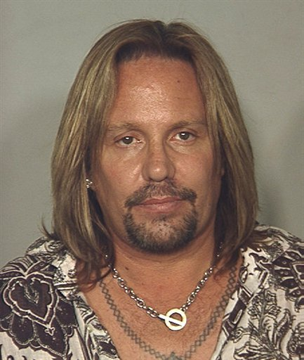 In this photo released by the Las Vegas Metropolitan Police Department showing Motley Crue singer Vince Neil who was arrested in Las Vegas on a drunken driving charge on early Monday, June 28,2010.