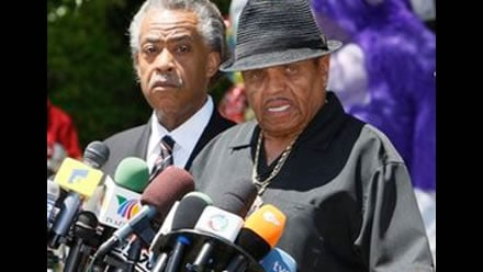 FILE - In this June 29, 2009 file photo, the Rev. Al Sharpton, left, listens as Joe Jackson, Michael Jackson's father, speaks at a news conference in front of the the Jackson family residence in Encino, Calif.