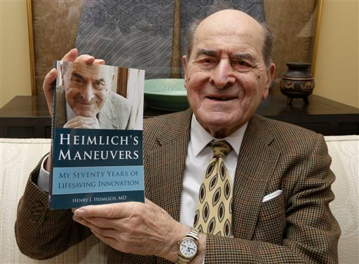 In this Wednesday, Feb. 5, 2014 photo, Dr. Henry Heimlich holds his memoirs prior to being interviewed at his home in Cincinnati. (AP Photo/Al Behrman)