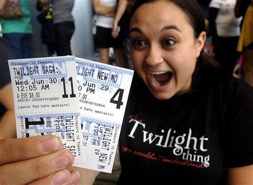 After buying tickets for the two Twilight series movies about 1 1/2 months ago, Alice Griffin, 23, of Las Cruces becomes excited Tuesday, June 29, 2010, at the Cineport 10 in Las Cruces, N.M.