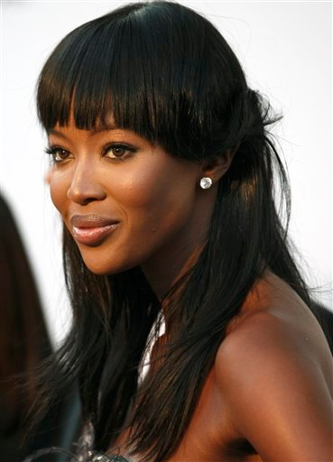 n this Thursday, May 20, 2010 file photo, British model Naomi Campbell arrives for the amfAR Cinema Against AIDS benefit, during the 63rd Cannes international film festival, in Cap d'Antibes, southern France.