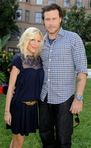 In this April 26, 2010 file photo, Tori Spelling and husband Dean McDermott pose together during the NBC Universal 2010 Summer Press Day in Pasadena, Calif. (AP Photo/Chris Pizzello, file)