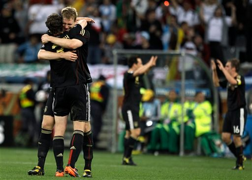 Germany's Arne Friedrich, left with back to camera, celebrates with Germany's Per Mertesacker after their teammate Miroslav Klose scored their side's fourth goal during the World Cup quarterfinal. (AP Photo/Julie Jacobson)