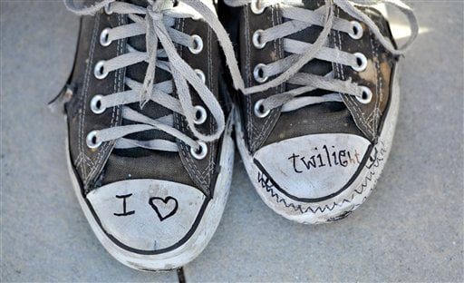 """Twilight"" fan Katherine Ramirez, 14, of Rancho Cucamonga, Calif., shows off her sneakers as she awaits Thursday's ""The Twilight Saga: Eclipse"" premiere at Nokia Plaza in Los Angeles, Wednesday, June 23, 2010. (AP Photo/Chris Pizzello)"