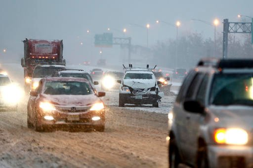 AP Photo/Julio Cortez). A vehicle involved in a crash sits on the fast lane of Highway Interstate 80 after an accident during a snowfall, Saturday, Dec. 17, 2016, in Lodi, N.J.