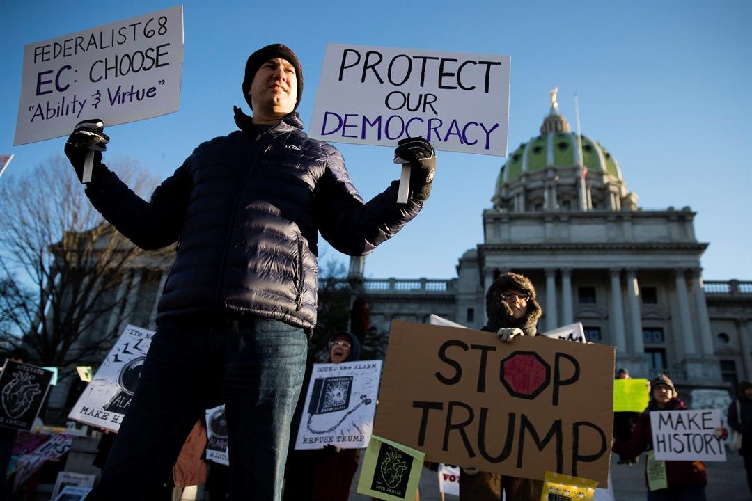 Protesters demonstrate ahead of Pennsylvania's 58th Electoral College at the state Capitol in Harrisburg, Pa., Monday, Dec. 19, 2016. (AP Photo/Matt Rourke)