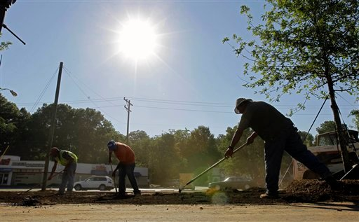 Construction workers toll under the sun in Charlotte, N.C., Tuesday, July 6, 2010 where temperatures are expected climb. (AP Photo/Chuck Burton)