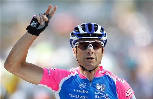 Italy's Alessandro Petacchi flashes two fingers for his second sprint victory in this year's Tour de France as he crosses the finish line to win the fourth stage of the Tour de France, Wednesday, July 7, 2010. (AP Photo/Laurent Rebours)