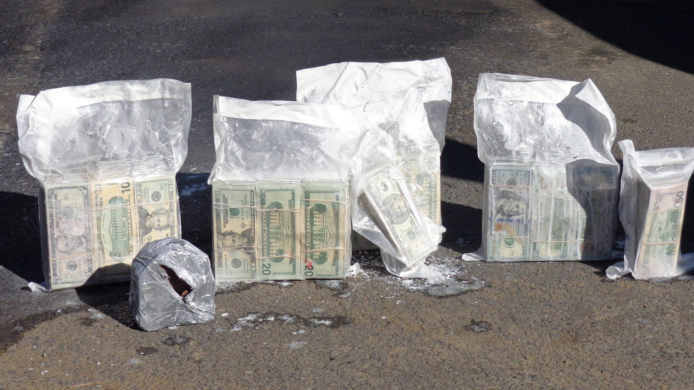 Agents confiscated $290,000 from the five-gallon paint can. (Photo courtesy of U.S. Customs and Border Protection)