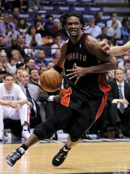 FILE - This March 20, 2010, file photo shows Toronto Raptors' Chris Bosh driving to the basket during an NBA game against the New Jersey Nets, in East Rutherford, N.J.