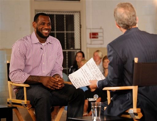 In a photo provided by ESPN, LeBron James sits with Jim Gray before an interview on ESPN on Thursday, July 8, 2010, in Greenwich, Conn. (AP Photo/ESPN, Rich Arden)