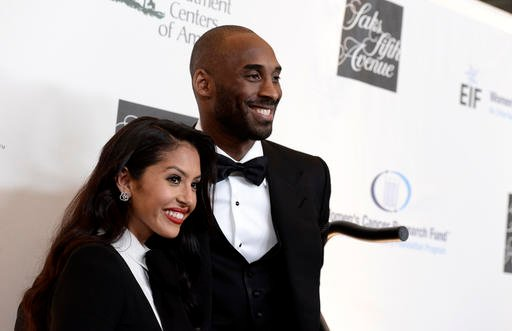 In this May 2, 2013, file photo, Lakers guard Kobe Bryant, right, and his wife Vanessa Bryant.