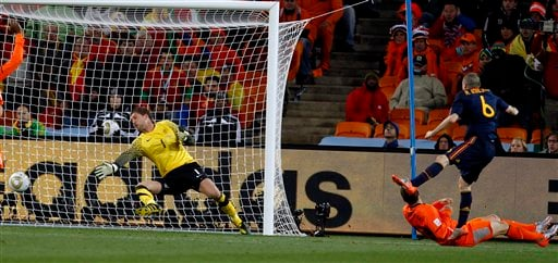 Spain's Andres Iniesta, right, scores his side's opening goal past Netherlands goalkeeper Maarten Stekelenburg, left, during the World Cup final.  (AP Photo/Bernat Armangue)