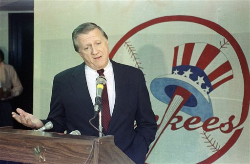 In a Monday, Aug. 21, 1990, photo, George Steinbrenner gestures during a news conference after resigning as general manager of the New York Yankees at Yankee Stadium in New York. (AP Photo/Ron Frehm, File)