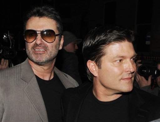 George Michael and partner Kenny Goss arrive at the Linda McCartney Photographs Private View at the James Hyman Gallery, 5 Savile Row, London.