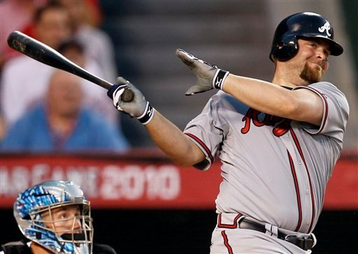 The National League's Brian McCann, of the Atlanta Braves hits a three-run double during the seventh inning of the All-Star baseball game Tuesday, July 13, 2010, in Anaheim, Calif. (AP Photo/Chris Carlson)