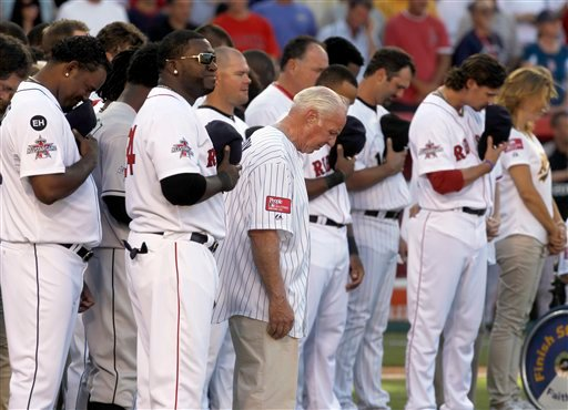 Players share a moment of silence for New York Yankees owner George Steinbrenner before the All-Star baseball game.