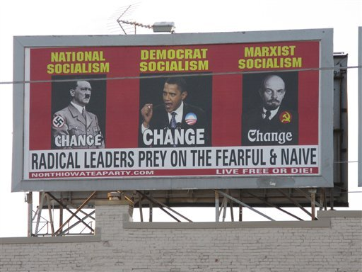 A billboard ordered and paid for by the North Iowa Tea Party shows President Barack Obama, Adolf Hitler, left, and Vladimir Lenin, on South Federal Avenue in Mason City, Iowa. (AP Photo/Globe Gazette, Deb Nicklay)
