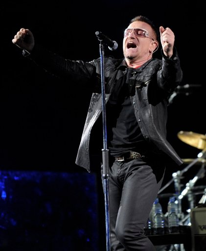 In this Oct. 25, 2009 file photo, Bono of the Irish rock band U2 performs during their 360 world tour stop at the Rose Bowl in Pasadena, Calif. (AP Photo/Chris Pizzello, file)