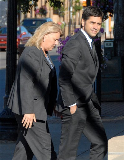 Actor John Stamos, right, arrives at the federal courthouse for the second day of an extortion trial, in which Stamos was the alleged victim, in U.S. District Court in Marquette, Mich. Tuesday, July 13, 2010.